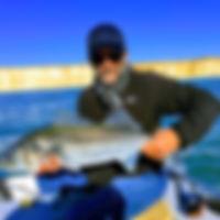 Angler holding a bass he caught