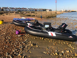 Two Hydrus inflatable boats on the beach ready to launch