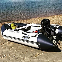Kolibri inflatable boat with outboard engine by the sea