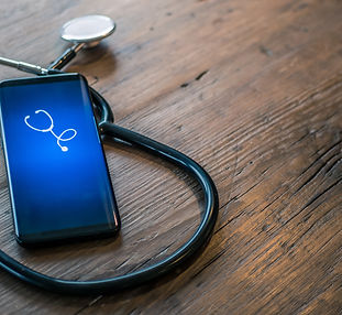 Mobile phone with healthcare app on wood
