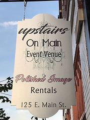 Upstairs on Main Venue Building Sign