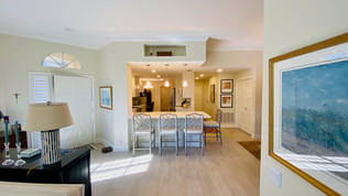 12. Wide view of kitchen and living room on Quail Crown Dr.