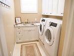 Cabinets installed in laundry room of home in Grandezza, Estero, FL