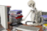 Man Working At Desk So Long He Has Become A Skeleton