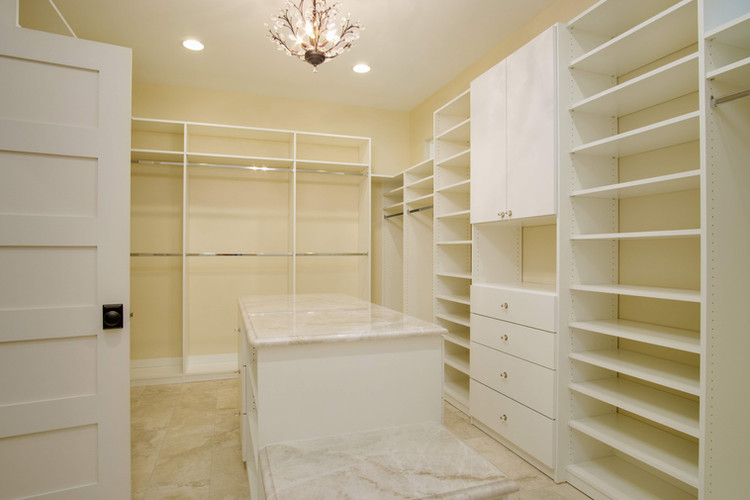 Huge Master Closet with custom shelving and island