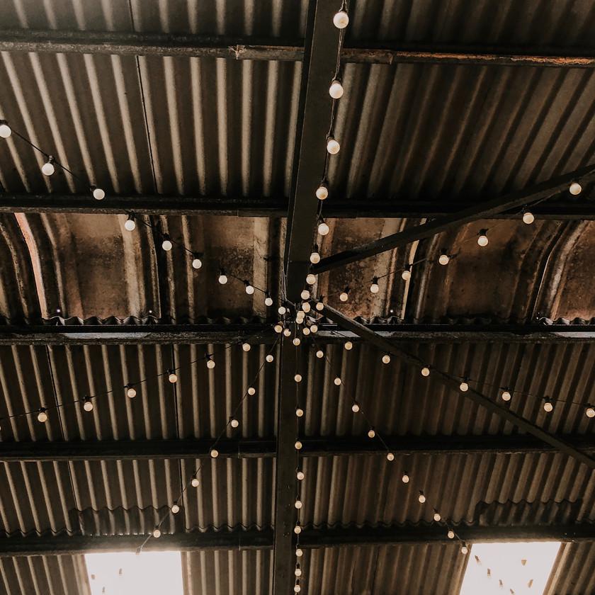 Industrial barn wedding, festoon lights