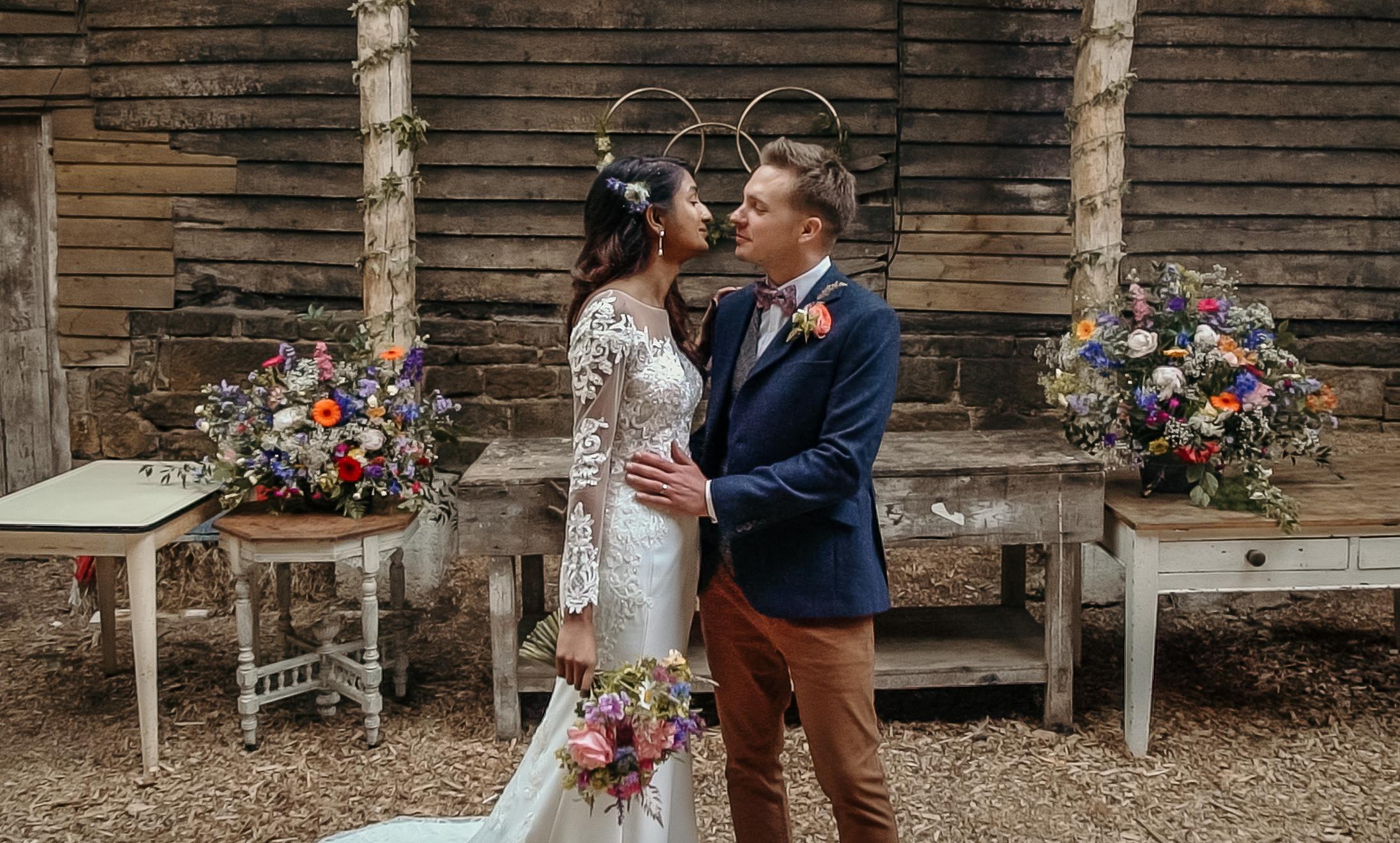 Boho, industrial, rustic barn wedding venue, colourful flowers