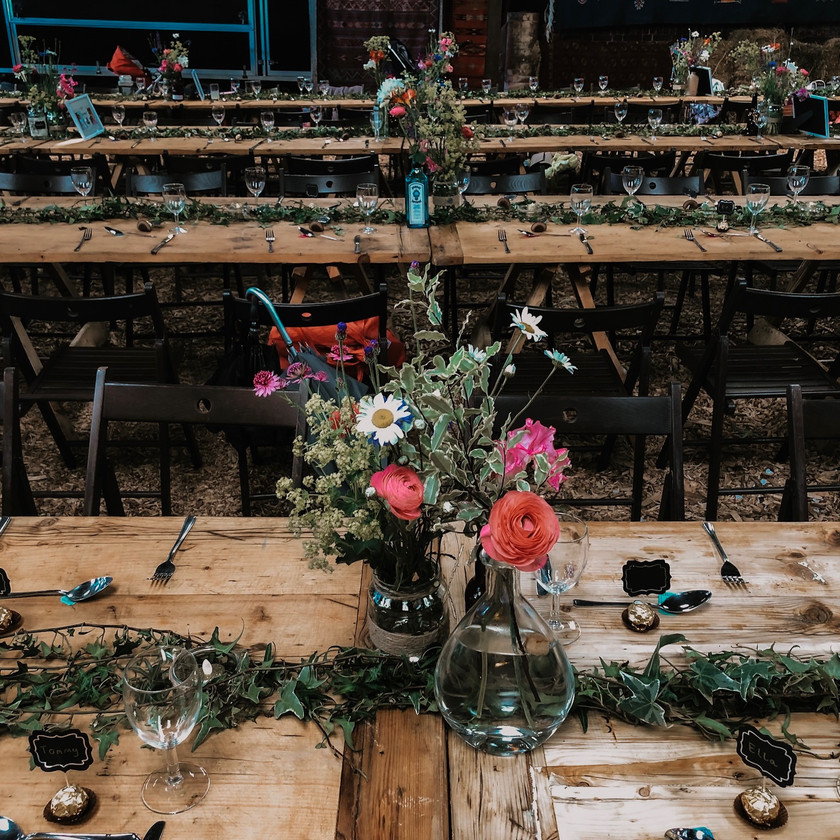 Simple, DIY wedding table settings, ivy table runners and wild flowers