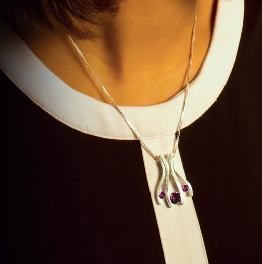 Sterling silver pendant with three tension-set amethysts.  Price: SOLD