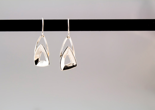 Combination of casting and fabrication to create these simple sterling silver earrings.  Price: $75