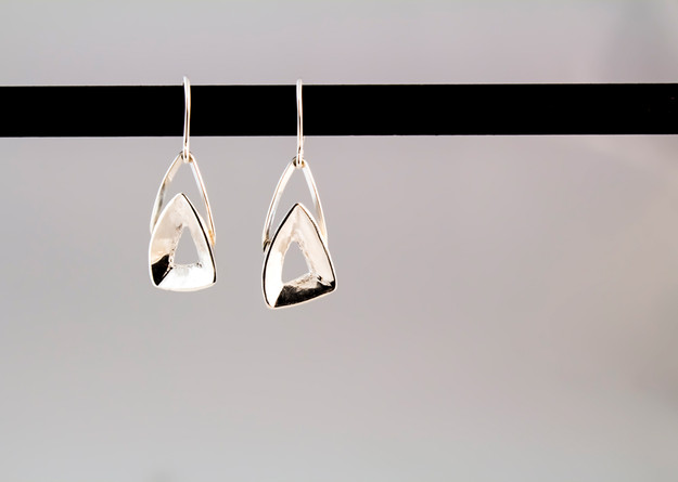 Combination of casting and fabrication to create these simple sterling silver earrings.