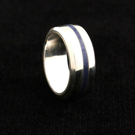 Cast sterling silver with crushed lapis lazuli inlay.  Ring Size US: 8.25 Price: $100
