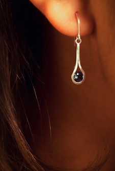 Sterling silver with tension-set london blue topaz (6mm).  Price: $100