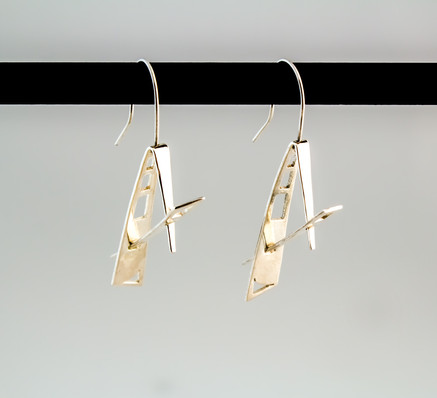 Fabricated sterling silver earrings.  Price: $75
