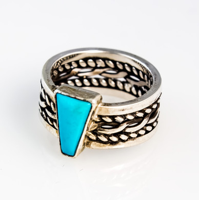 Sterling silver braded band with custom-cut turquoise.  Price: Not For Sale
