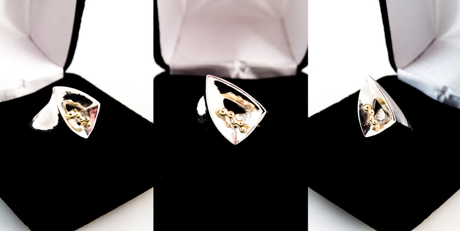 Sterling silver cast ring with 14k yellow gold organic accent.  Ring Size US: 4 Price: $300
