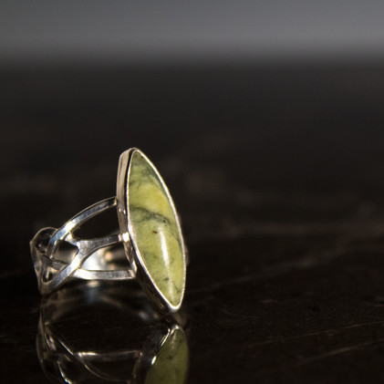 Sterling silver Celtic inspired ring. Band is hand-carved with a custom-cut Connemara marble cabochon. Marble was selected by myself during a trip to Ireland.  Price: SOLD