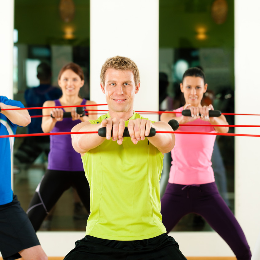 Group of five people exercising with flexi bar to strengthen the intrinsic muscles in gym or fitness