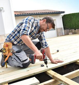 Carpenter building wooden deck .jpg