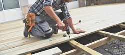 Carpenter building wooden deck _edited