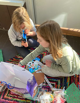 students opening gifts