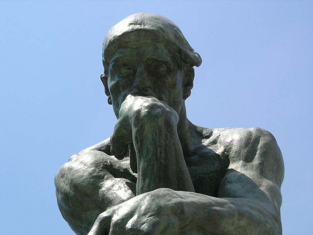 A photo of The Thinker statue.