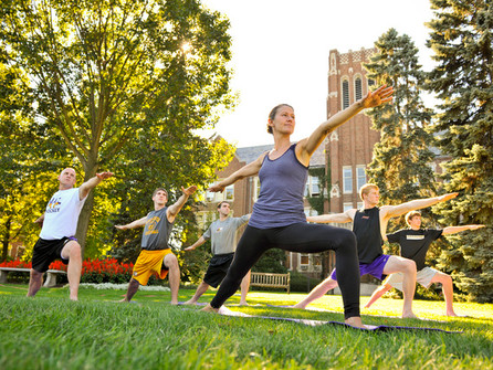 Yoga Service within a College Community - Roc Yoga Revolution featured on Huffpost