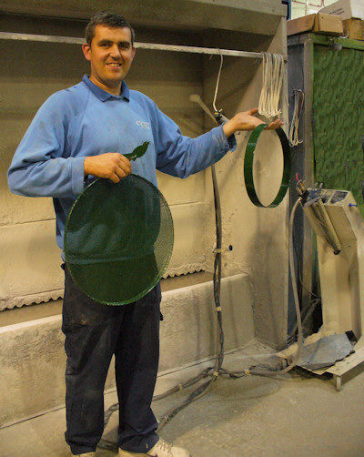 Keith with a bird, bird table and hoop he has powder coated for us