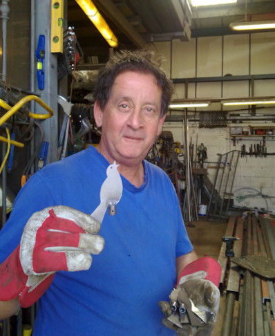 Chris Brown metal worker with a laser cut bird he has cut, tapped and welded a sleeve to
