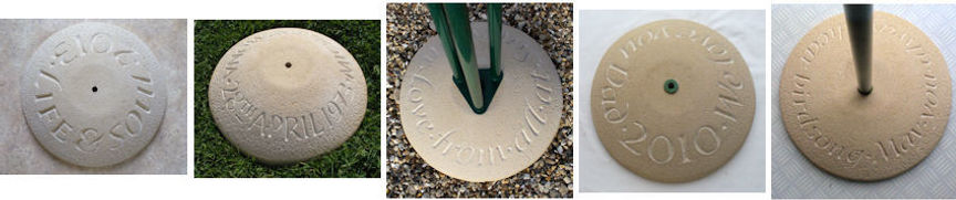 Stone bird table bases with examples of carved lettering in them