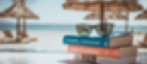 holiday-reading-books-on-beach.jpg