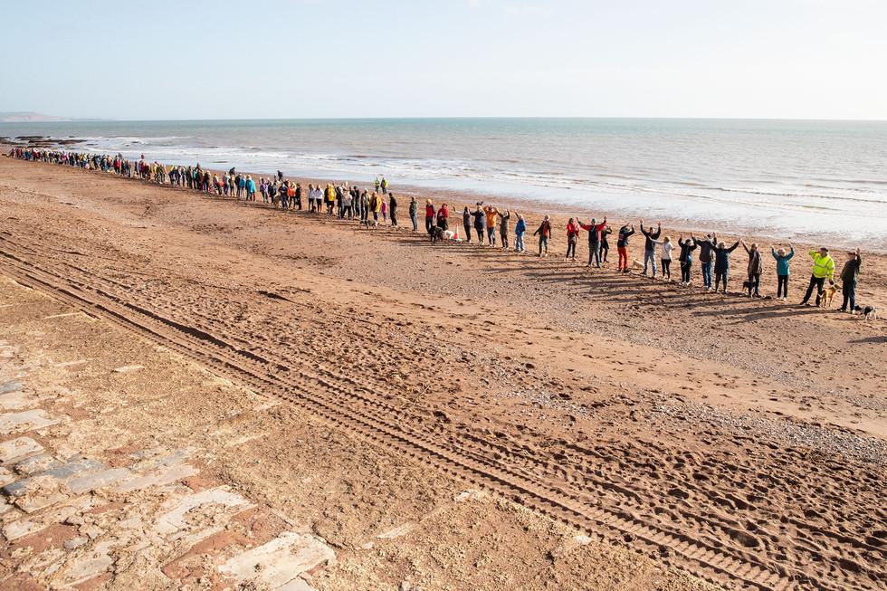 Human chain on Teignmouth Beach