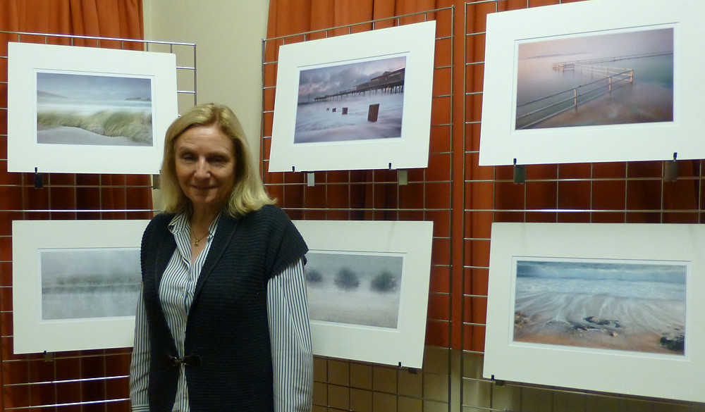 Linda Weevil beside some of her prints