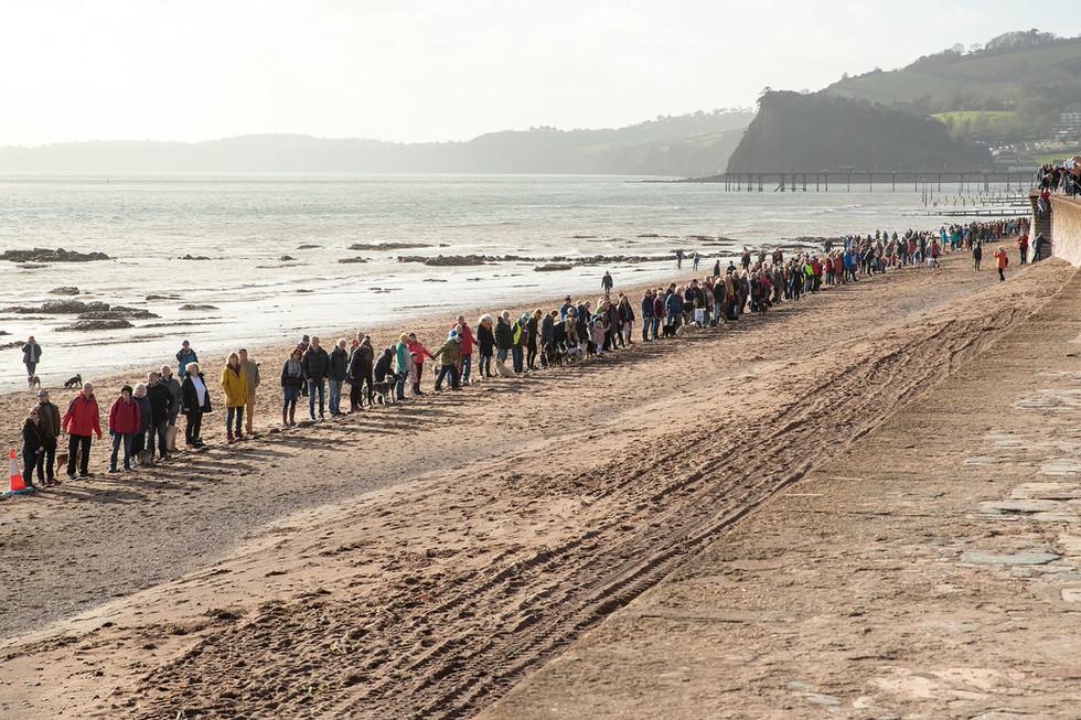 The Human Chain along Teignmouth Beach