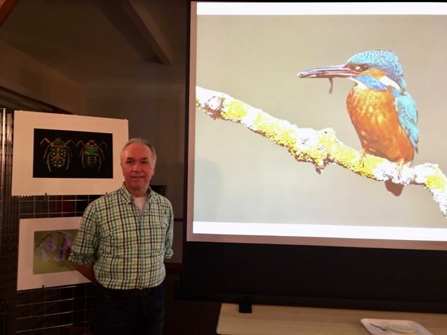 Andrew McCarthy with his photograph of a kingfisher eating a fish