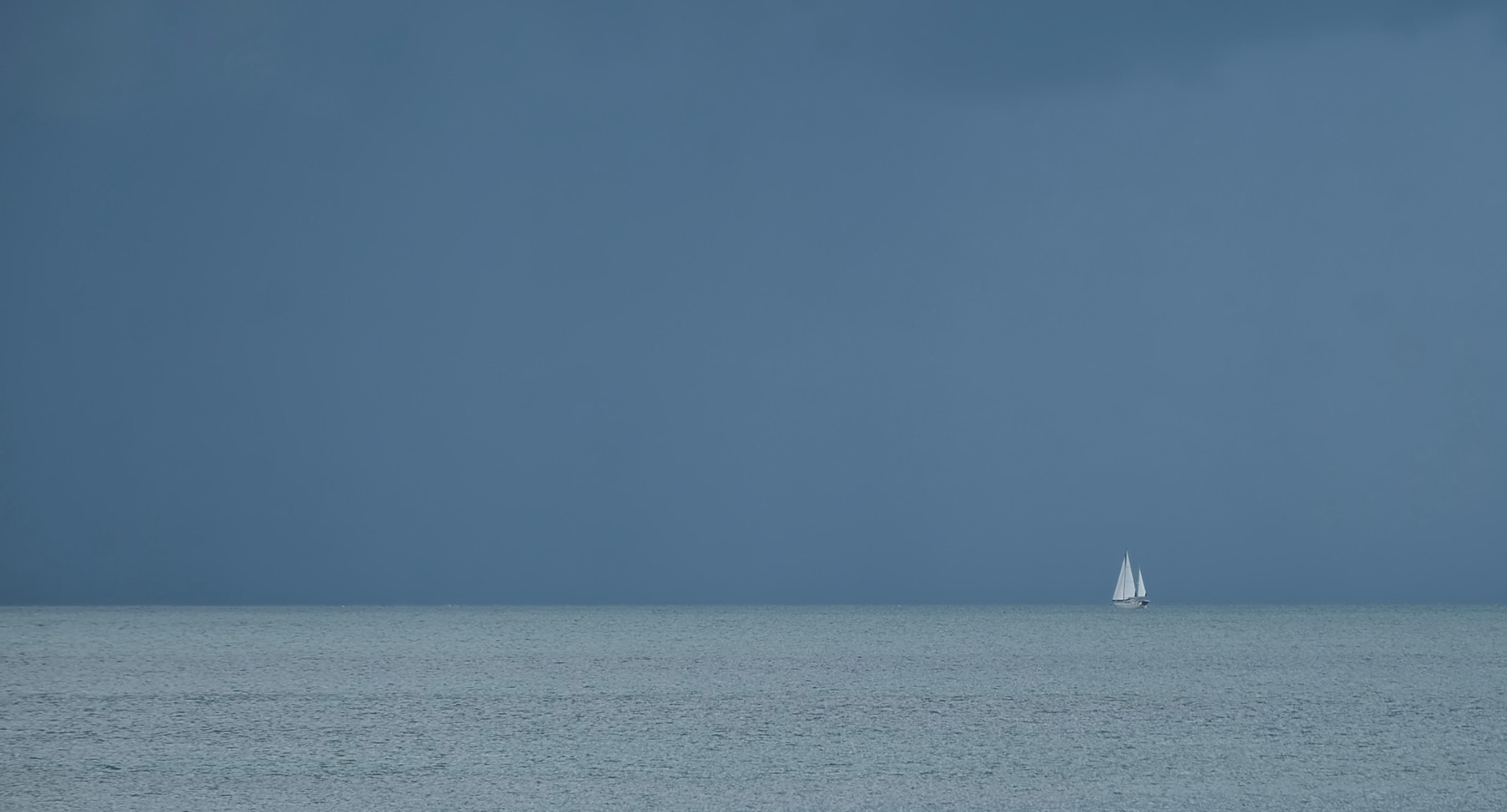 Lone yacht at sea