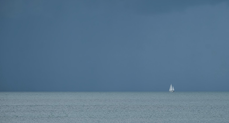 Lone yacht at sea