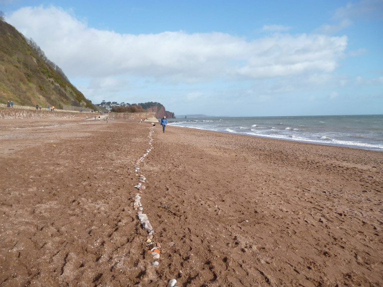 The line of the new sea wall in pebbles