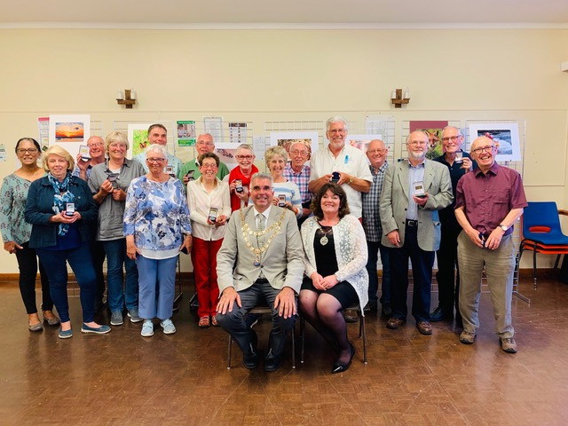 The new Mayor of Teignmouth, Robert Phipps, with the winning members of the Dawlish & Teignmouth Camera Club for their end of season finale, the Awards Evening.