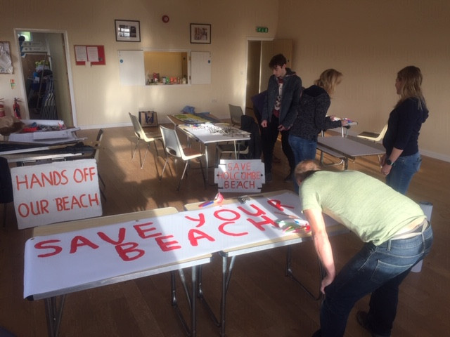 Painting Save Your Beach banners at Holcombe Village Hall