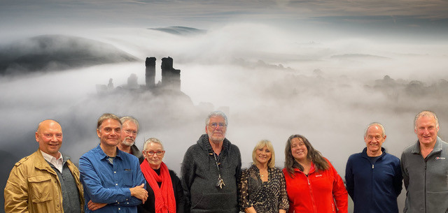 Standing in front of Alex Rosen's winning photo of Corfe Castle in the mist (L to R) Marc Dunlop, Paul Hepple, Bob Kent, Bobbie Smith, Bob Normand, Judge Marija Lees, Naomi Stolow, Ken Holland and Alex Rosen