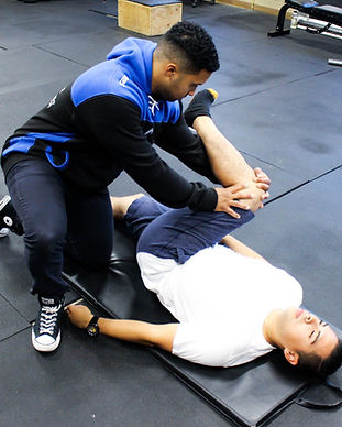 Registered Massage Therapist stretching patient