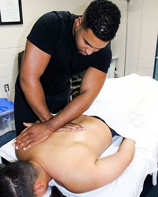 Registered Massage Therapist treating back pain