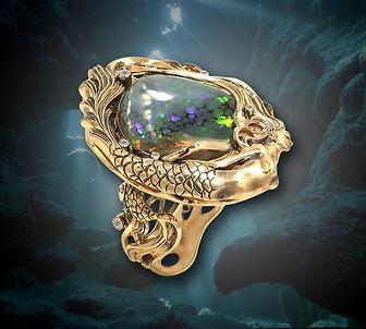 роскошное золотое кольцо с черным австралийским опалом