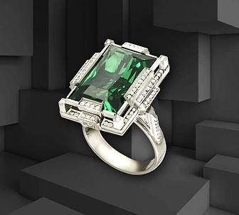 кольцо из белого золота с крупным изумрудом