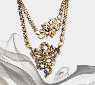 кулон змея из золота с сапфирами