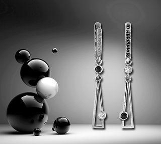 серьги из белого золота с белыми и черными бриллиантами