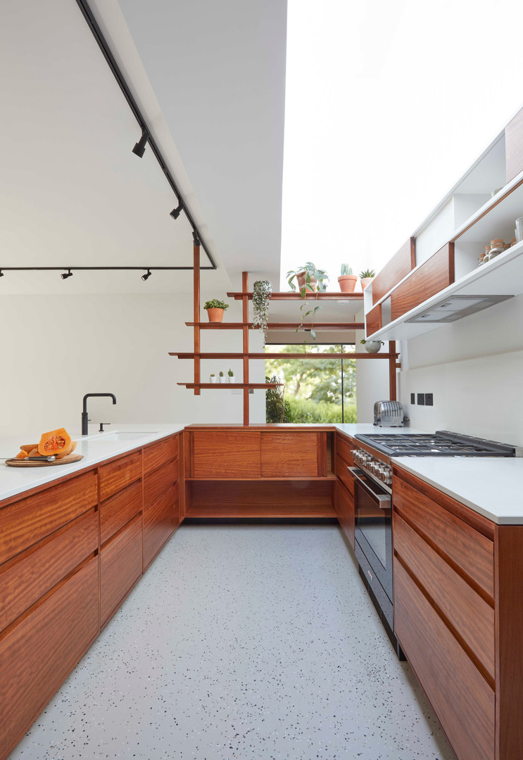 H Miller Bros | Luxury kitchen makers | bespoke handmade divider screen in iroko | Liverpool, Manchester, Cheshire, and Wirral