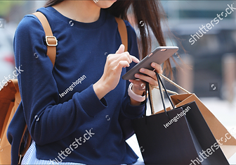 women with phone.PNG