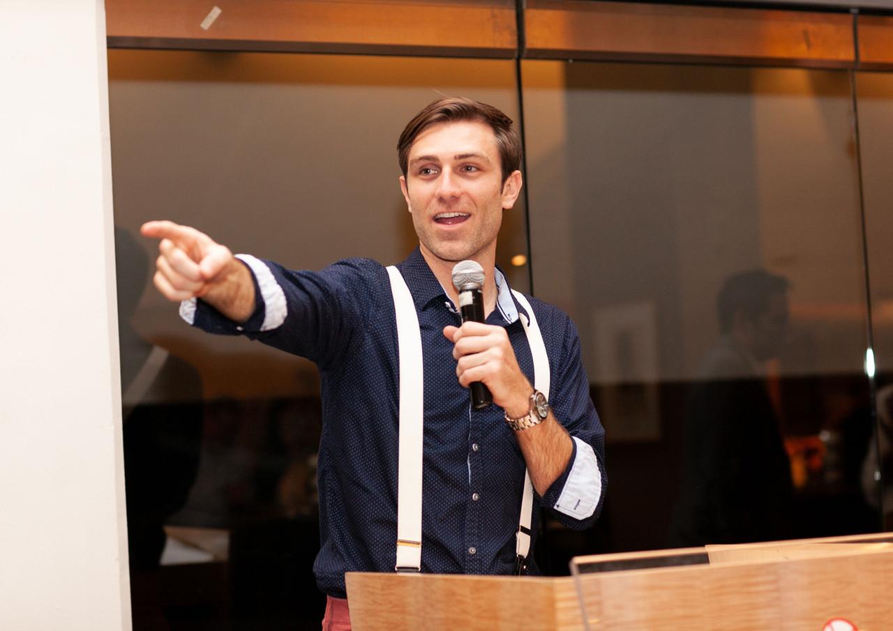 Jacob at podium pointing Angel Network Gala.jpg